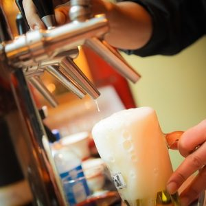 bartender pouring a beer at bar near apartment in wilmington de