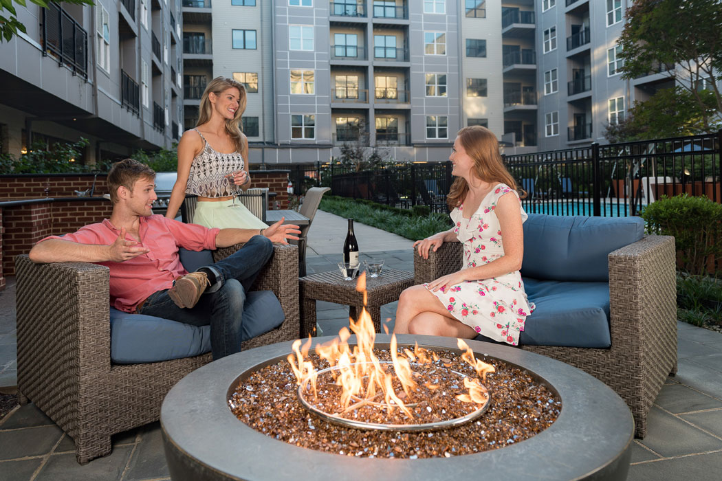 friends enjoying wine by firepits at apartment in wilmington de