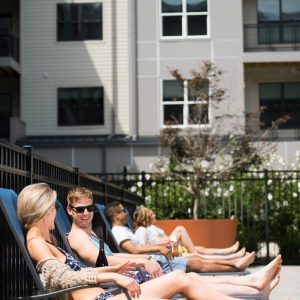 friends talking poolside at apartment in wilmington de