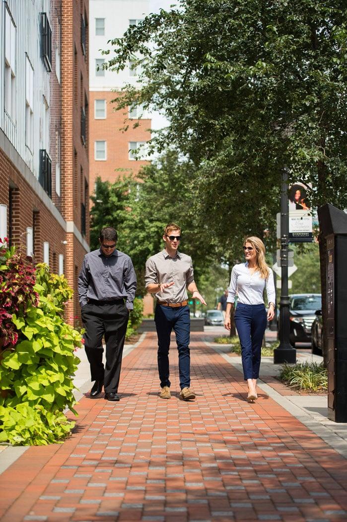 3 people walking on sidewalk near apartment in wilmington de
