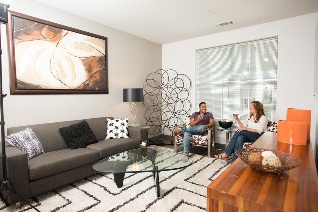 friends relaxing in living room at apartment in wilmington de