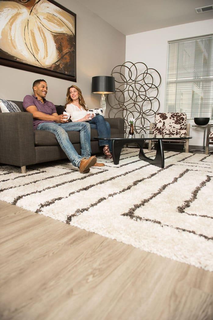 couple relaxing on sofa in apartment in wilmington de
