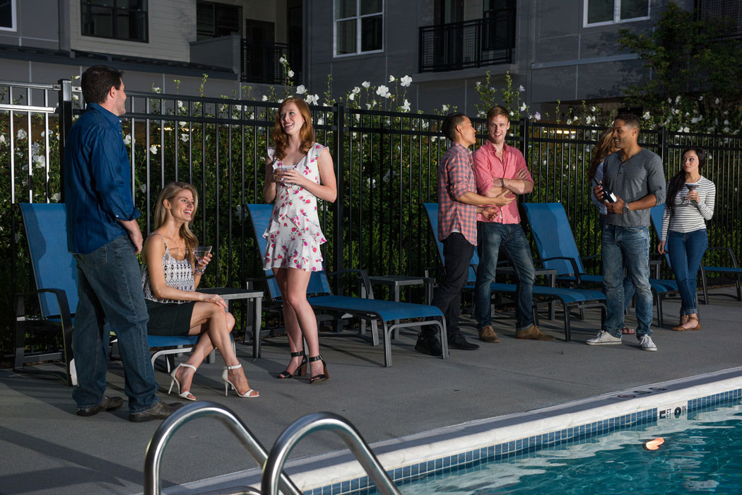 residents hanging out poolside at apartment in wilmington de