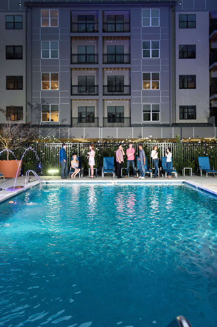 residents relaxing poolside at apartment in wilmington de