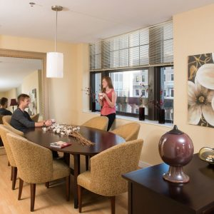 couple drinking coffee in dining area of apartment in wilmington de