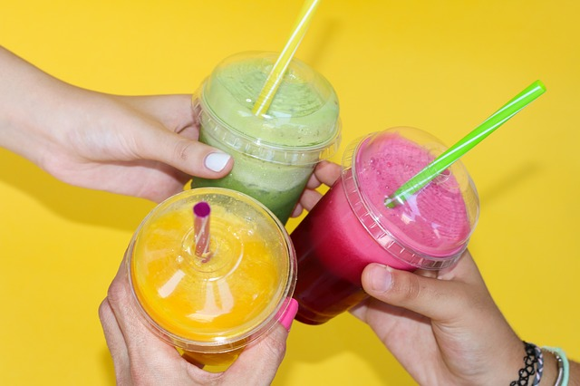 friends drinking smoothies near apartment in wilmington de