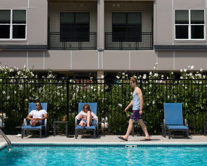 people lounge by pool at apartments in wilmington de