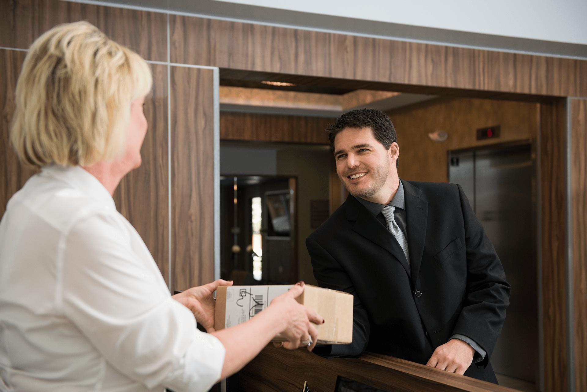 concierge receiving package at harlan flats in wilmington de